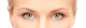 eyelid surgery, blepharoplasty - closeup of face of beautiful young woman