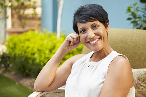 Portrait of Mature Woman Relaxing Outdoors In Garden | Georgia Dermatology Center