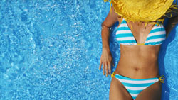 photo of woman lounging by pool